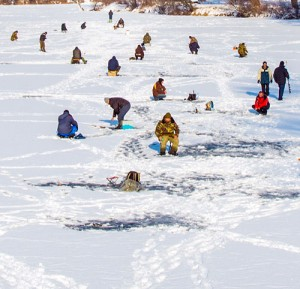 Ice fishing the frozen river