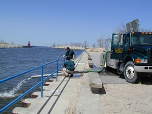 DNR employees stocking fish off pier in Holland
